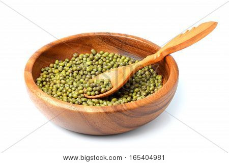 Raw mung bean in a wooden bowl with a spoon.Isolated on a white background.