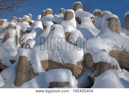 Tetrapods Covered With White Snow