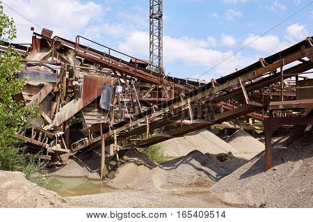 Old stone crushing plant. Gravel mill. Industry.