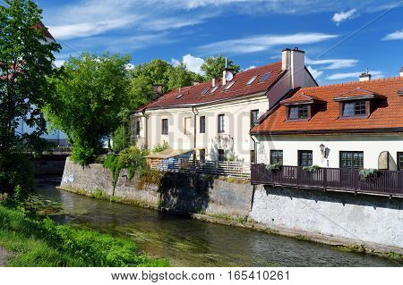 Vilnius, Lithuania - August 11, 2016: Vilnele River Flowing Past Uzupis District, A Neighborhood In