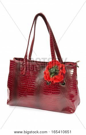 Brooch made of felt wool in the form of a poppy on a woman's bag