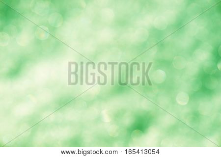 Blurred green background with bokeh lights, green texture