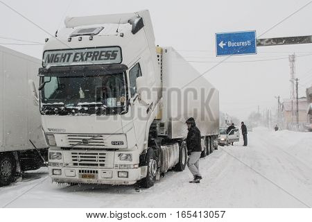 Afumati Romania January 26 2014: Trucks are parked on a closed road in Afumati because of the severe weather conditions.