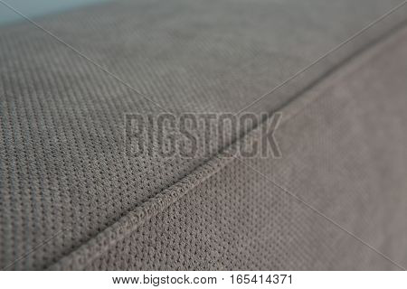 Texture of mattress with no pattern and pictures. Grey colored mattress of bed in bedroom. Mattress of bed in bedroom.