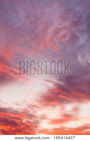 Romantic and dramatic cloud formation on dusk sky. orange and purple landscape with sunlight.