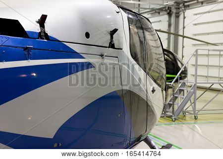 Small Private Helicopter Parked In The Hangar.
