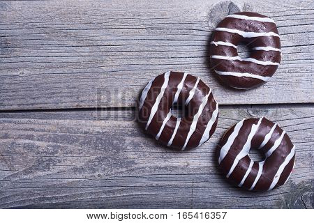 assorted donuts with chocolate frosted pink glazed