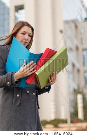 Business Woman Holding Folders With Documents Outdoors