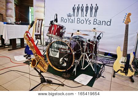 Hai, Ukraine - January 5, 2017: Musical Instruments With Saxo, Bass Guitar And Yamaha Drums On Stage