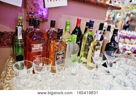 Hai, Ukraine - January 5, 2017: Different Bottles On Bar With Glasses.