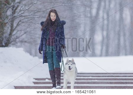 Portrait of Pretty Smiling Woman Walking with Her Dog Outside. Horizontall Image Composition