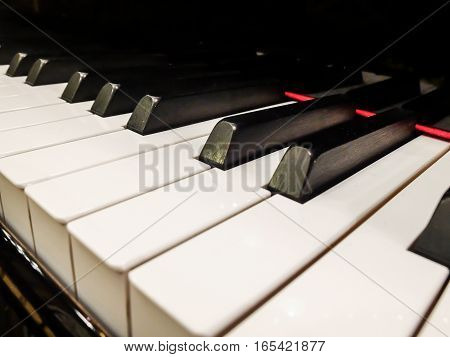 Bucharest Romania March 9 2016: Close up photo of piano keys with foreground and background fading into the distance.