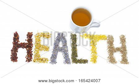 Word Health posted of dried herbs and flowers folk medicine of nature. Cup of tea. Treats force of nature. Cynosbati Matricaria chamomilla lavandulae Urtica Helichrysum arenarium AsteraceaePolygonum aviculare.