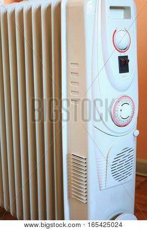 White eletric radiator heater with thermostat .