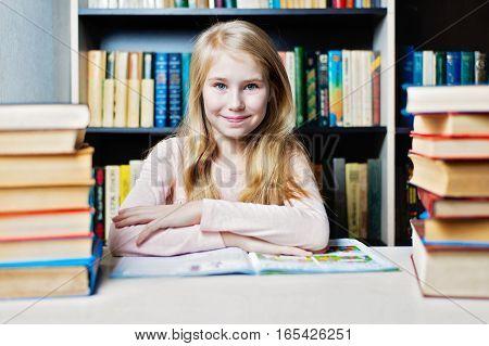 Smiling Teenage Girl Between Stack Of Book