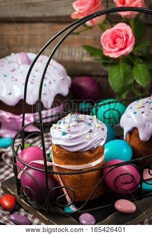 Delicious homemade holiday Easter cakes and colored eggs