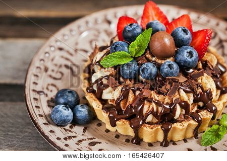 Banoffee Chocolate Pie Decorated With Chocolate, Fresh Blueberry And Strawberry