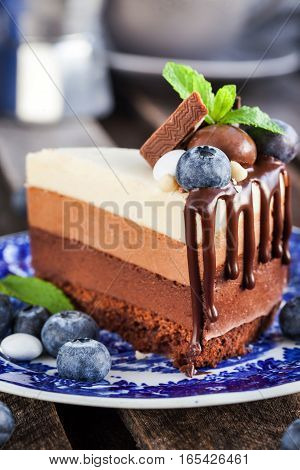 Piece Of Delicious Chocolate Mousse Cake Decorated With Fresh Blueberry, Mint And Candies