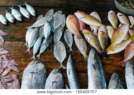 fresh fish and other seafood on a wooden table