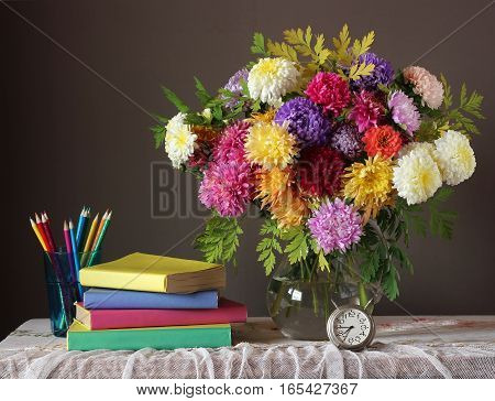 Still life with autumn bouquet and books. Back to school. The teacher's day. September 1.