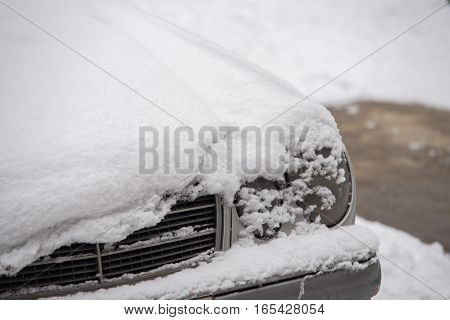 Car Covered With Snow In The City