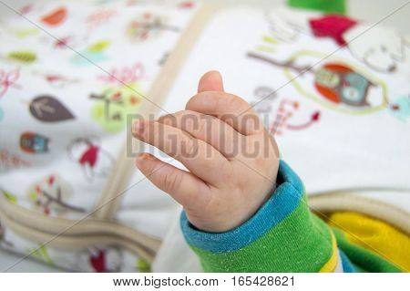 small baby's hand close-up on a light background
