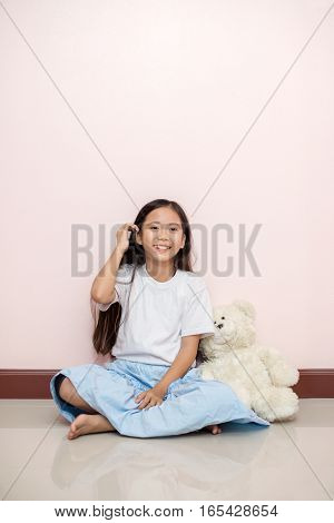 Child Little Girl Asian Thai Nationality With White Toy Teddy Bear Smile Feeling Over Pink Wall Back