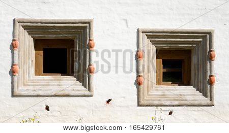 Windows of old building in Kirillo-Belozersky monastery Vologda region Russia.