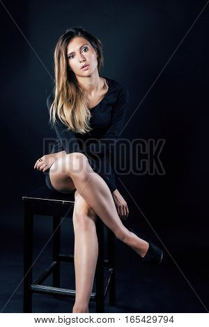 young blond real woman emotional in depression dark indoor, beautiful sadness