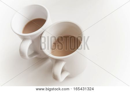 Two Big Cups Full Of Coffee With Milk