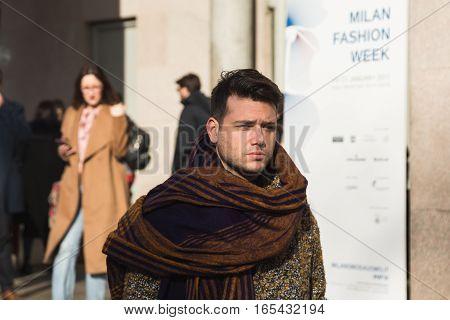 MILAN ITALY - JANUARY 14: Fashionable man poses outside Antonio Marras fashion show building during Milan Men's Fashion Week on JANUARY 14 2017 in Milan.