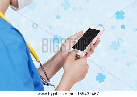 Female Nurse Using Pink Mobile Dark Screen Over Abstract Hospital Icon Background.