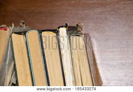 The old books on the wooden table