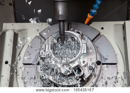 boring metal drilling: drilling hole or boring detail with lubricant liquid coolant on metal cutting