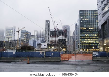 Boston Massachusetts USA - March 17 2016: Tall buildings in Boston Seaport District and Financial District rise into low clouds