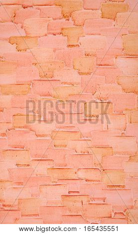 Decorative plaster on the wall, abstract background, imitation of  bricks