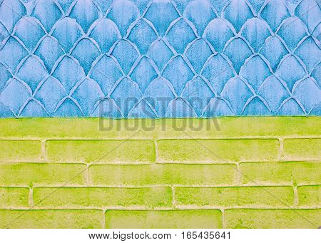 Decorative plaster on the wall, abstract background, imitation of scale