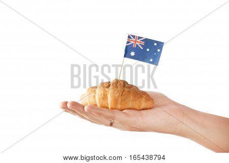 Fresh croissant and australian flag isolated on white background