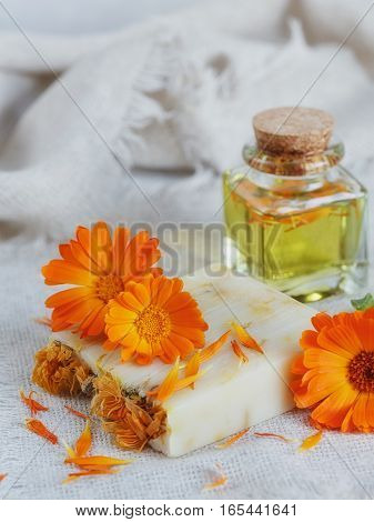 Natural handmade soap with calendula on white wooden background