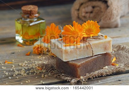 Natural handmade soap with calendula on rustic wooden background