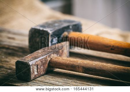Old Hammers On Wooden Background