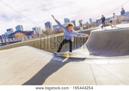 boy skating on skateboard in skate park. skateboarder riding skateboard. the concept of freestyle extreme sport. blurred background due to the concept. empty space for your text