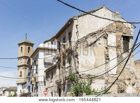 works in progress on a building and electric cables at Pinos Puente town, Granada, Spain