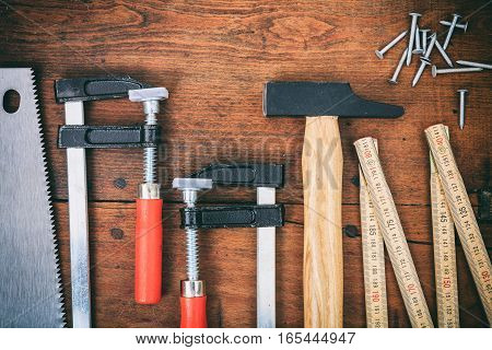 Tools And Nails On Wooden Background