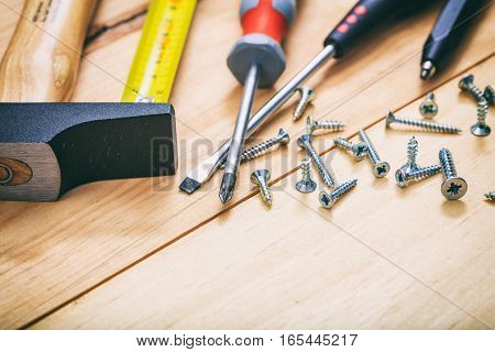 Hammer And Screwdrivers On Wooden Background