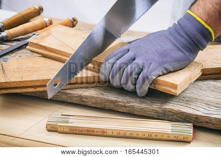 Man Working With A Hand Saw