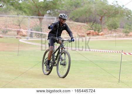 Happy Middle Aged Black African Man Riding To The Finish Line At Mountain Bike Race