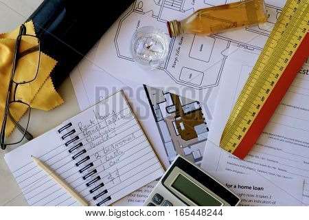 Real estate planning tools on a table.