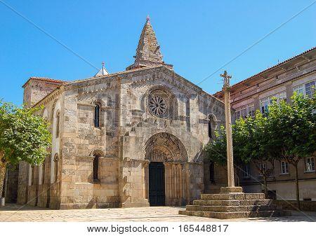 Stone cross in front of the church Colegiata de Santa María del Campo in La Coruna, Galicia, Spain