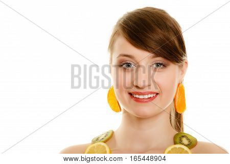Diet. Happy girl with necklace and earrings of fresh citrus fruits isolated on white. Young woman recommending healthy food and nutrition.
